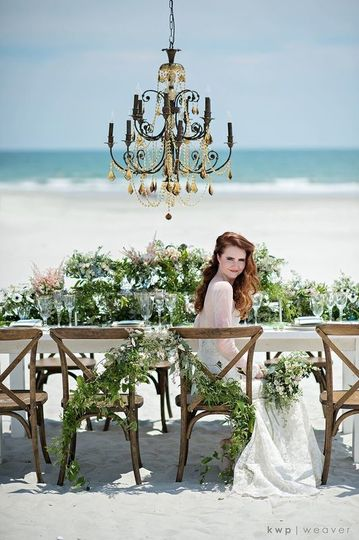 Bride at the table by the beach