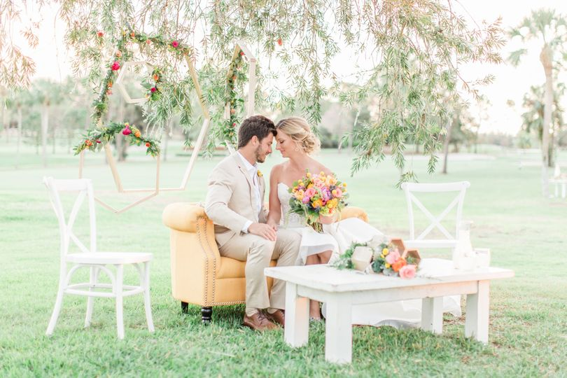 Bride and groom on their chair