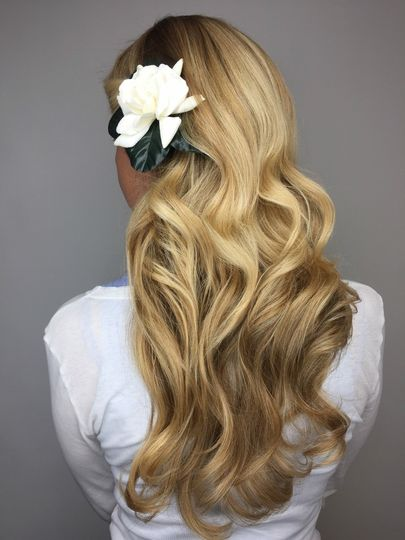 Blonde curls and flower pin