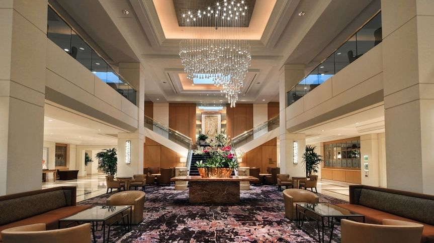 Our breathtaking lobby featuring our grand staircase & crystal chandeliers for a perfect photo op!