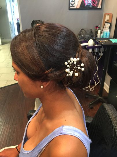 Flowers on bun updo