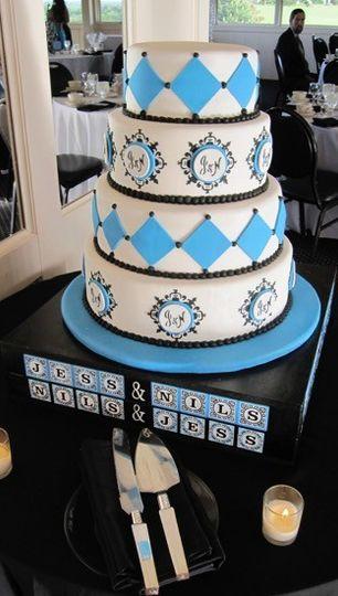 4-tier wedding cake with blue diamonds