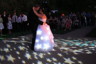 The First Dance with a Custom Introduction and Groom Voiceover and Specialty Lighting!