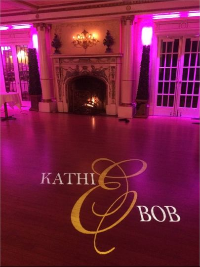 Custom Designed Personalized Monogram Projected on the Floor with Wine Colored Uplighting