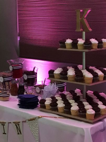 Dessert table with custom cupcake stand