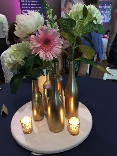 Single blooms in bottles