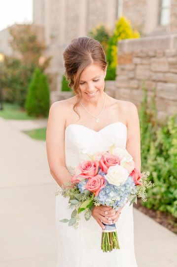 Happy bride with flowers