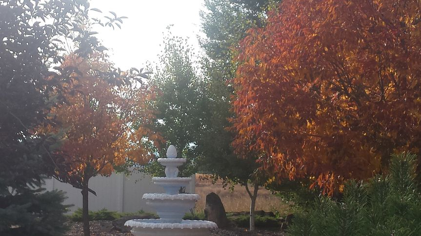 Tiered fountain by the autumn leaves
