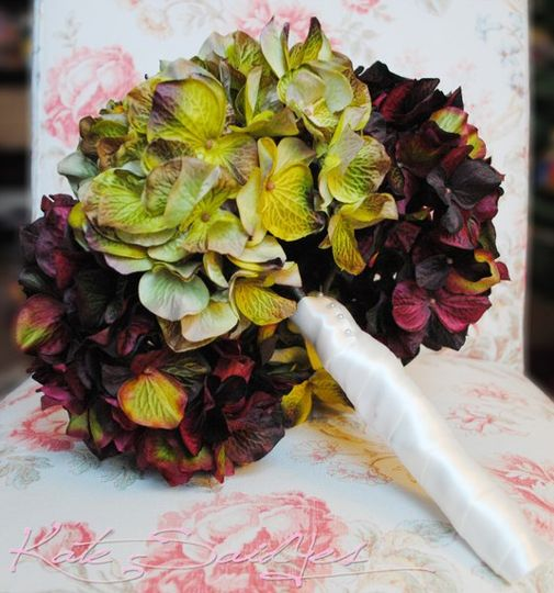 The Plum and Moss Green Hydrangea Bridal Bouquet is romantic and elegant, perfect for a spring or...