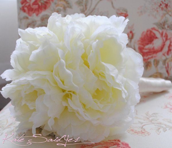 This romantic Cream Peony Wedding Bouquet is perfect for all of your bridesmaids. Bouquets are...