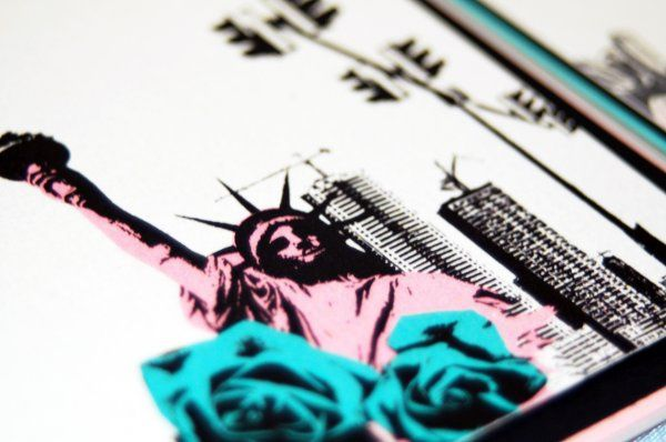 Statue of Liberty, rosettes, and city skyline