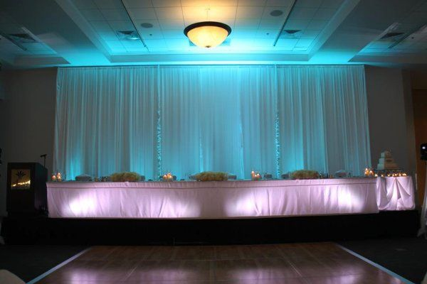 16' Head table drapery treatment highlighted with Tiffany Blue lighting. Head table and cake table...