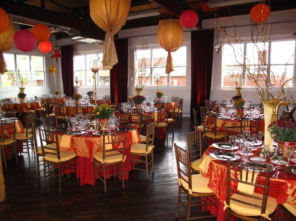 Layout of an event held at the Reading Art Works, tables are decorated in bright colors and paper lanterns adorn the ceiling