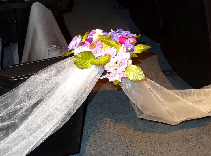 Floral arrangement on church pew.