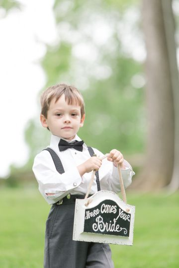 Little boy with the wedding sign