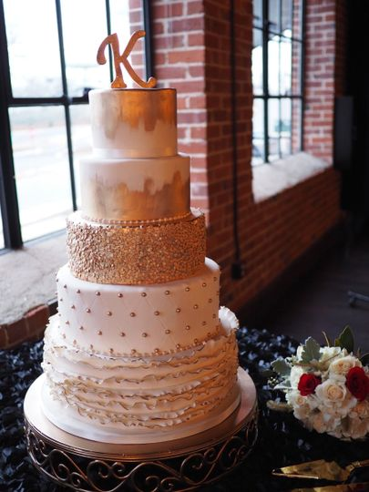 Gorgeous white and gold New Year's Eve wedding cake