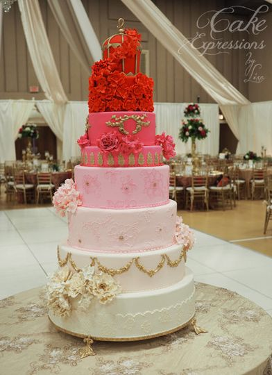 "Ombre wedding cake with ""birdcage"" top, hand made sugar flowers. Delicate gold accents"