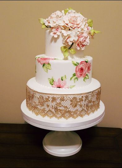 Hand painted roses, gold lace wedding cake