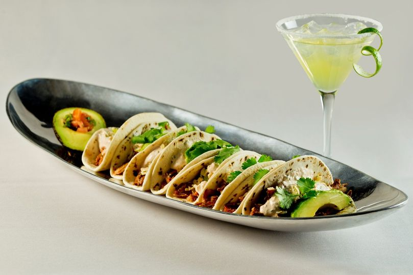 Bad penny beer braised pulled chicken taco with specialty margarita