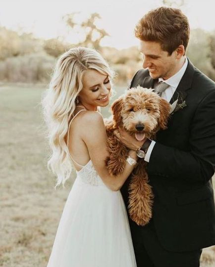 The bride and groom with a dog