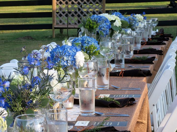 Long table setting with floral centerpiece