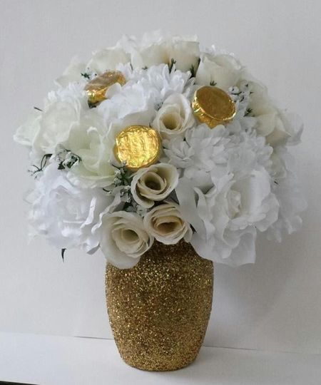 Edible Centerpiece.    Elegant floral arrangement with edible wedding favors attached (Chocolate...