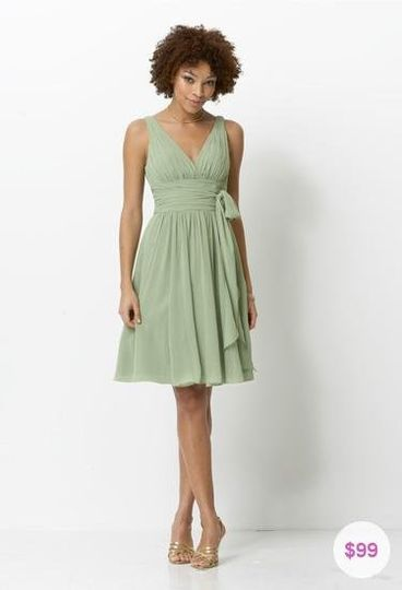 Simple and flattering chiffon, tea-length bridesmaid dress with v-neck and back interest. This style...