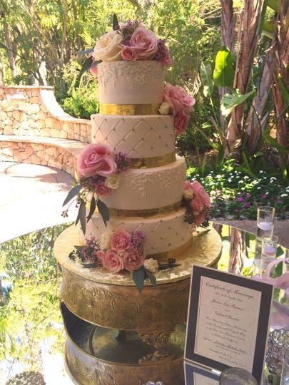 Cake on a gold riser.