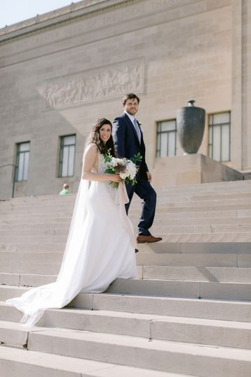 Couple on the stairs with bouquet