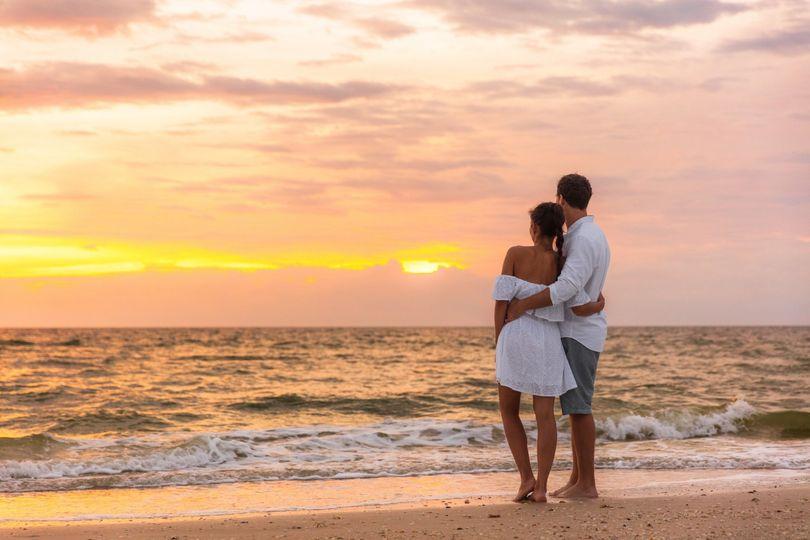 Honeymoon couple and sunset