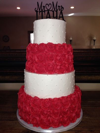Four tier white and red wedding cake