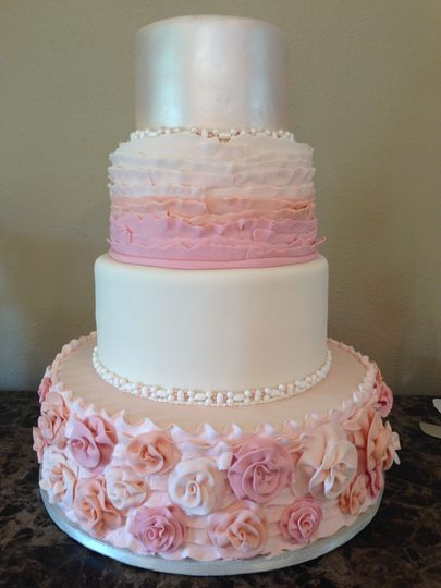 Four tier pink and white cake