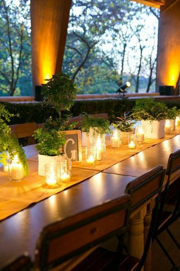 Candlelit inside the glass table centerpiece