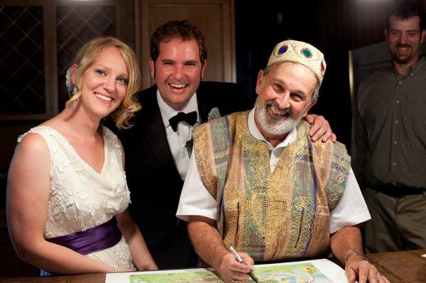 Jessica, Jon and Yehudah signing their wedding ketubah - marriage contract - all smiles!