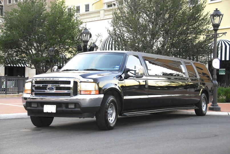 **Black Excursion SUV Limousine** Have a Killer Time! Step out with twelve of your closest friends...