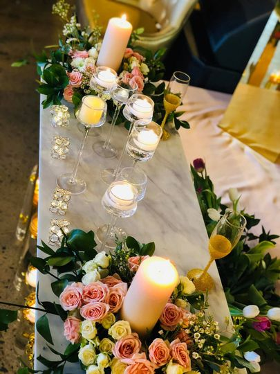 Candle and floral sweetheart table