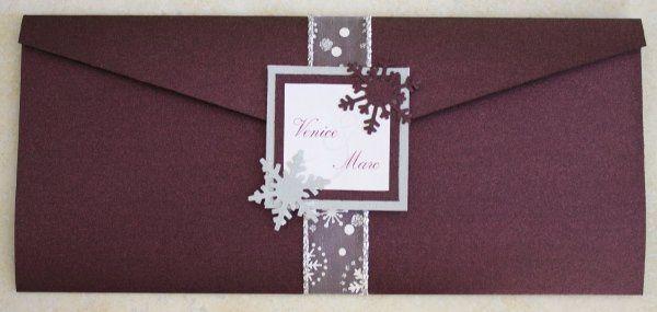 Eggplant Wedding Pocket that incorporates a snowflake theme for a winter wedding.
