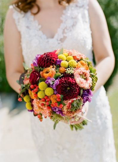 Cabbage roses, dahlias, stock, billy balls, and ranunculus were used in this design. Photography by...