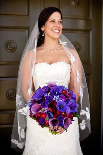 Dark purple orchids, red roses, red peony, purple hydrangea. Photography by Genevieve Leiper.