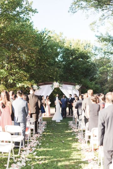 Ceremony aisle decorated with petals