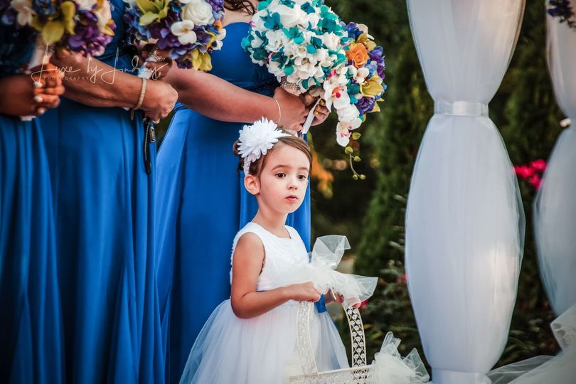 Flower girl watching the wedding ceremony