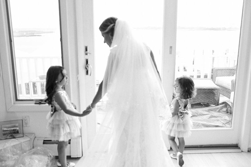 Bride shares a moment with her daughters after getting dressed for the wedding
