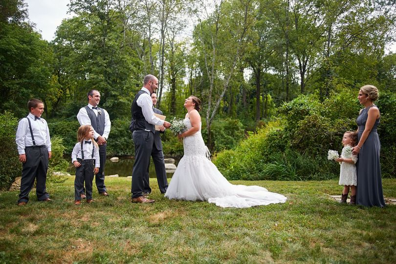 Bride and groom vows during their outdoor wedding ceremony