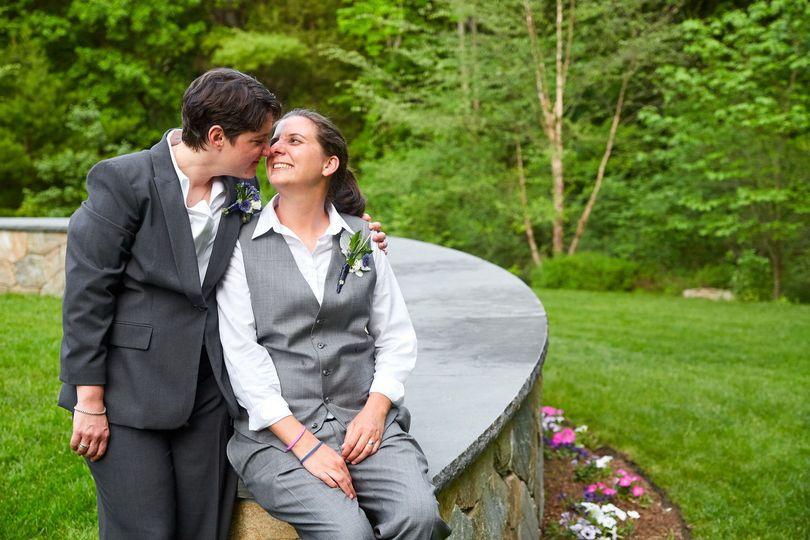 Portrait of two brides nuzzling
