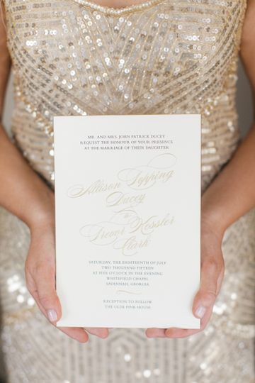 Bride holding out the invitation