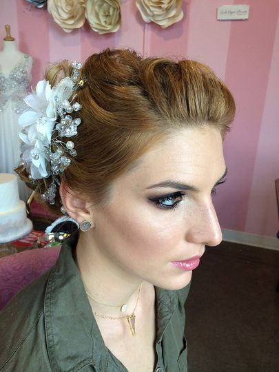 Wedding updo with white flowers