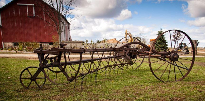 Antique Farm Equipment adorns the property