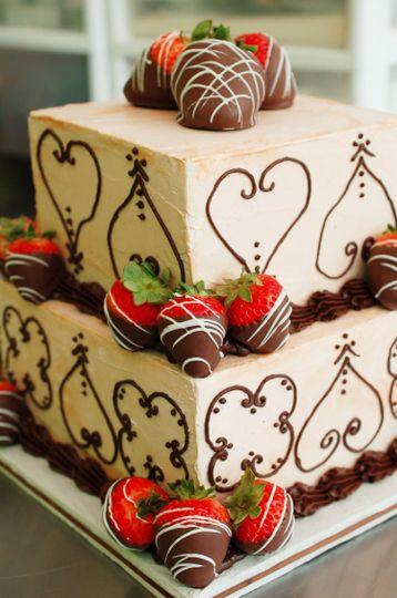 Romantic square chocolate flourish wedding cake with chocolate-covered strawberries