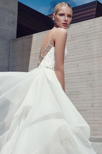 BlaireThis glamorous ballgown features a pleated bodice and tiered layers of Marquice organza....