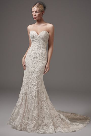 HadleyThis alluring fit-and-flare features striking lace motifs, a low back, and a sexy...